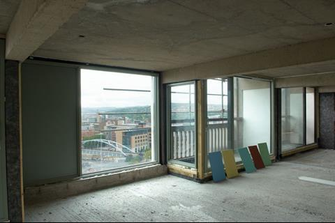 The windows were made bigger to get more light into the flat; these offer views over Sheffield